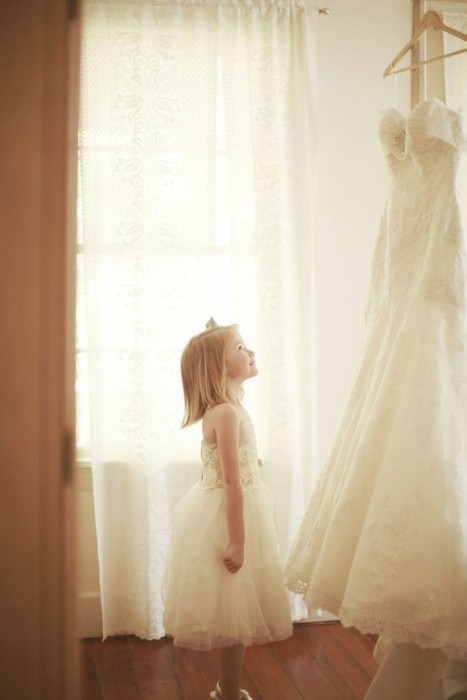 must-have-wedding-photos-flowergirl-looking-at-dress