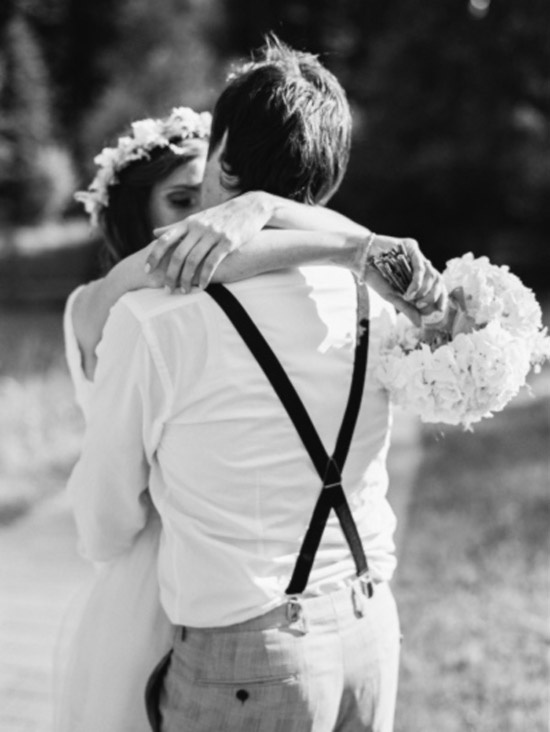 Must have candid wedding photo of bride and groom sharing a special moment in a warm embrace