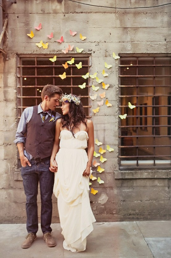 Inspirational photo for a handmade backdrop of paper watercolor butterflies for a wedding