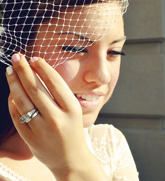 Julia in her beautiful birdcage veil and shy smile