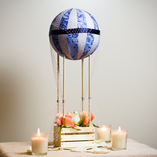 A beautiful diy handmade hot air balloon that would be a romantic centerpiece for your wedding tables!