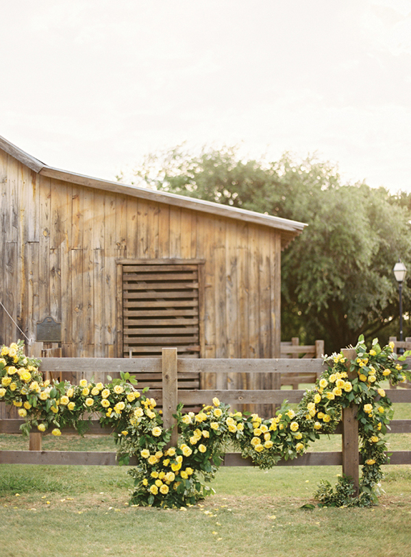 A beautiful and romantic yellow rose garland perfect for a rustic wedding both indoor and out