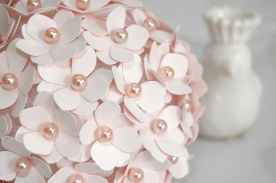 Feeling ambitious? This is a great and easy tutorial for a cute pomander flower ball! These would make great decor for your wedding/bridal shower tables!