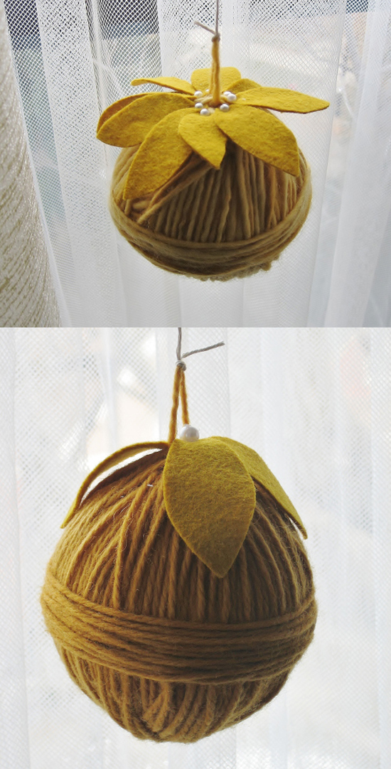 How cute is this yarn ornament? Beautiful textures of the yarn patterns and the look of the felt leaves - love it! This tutorial even uses one of my most favorite colors! These would make great gifts, wedding favors, or even decor to go alone with your centerpieces!