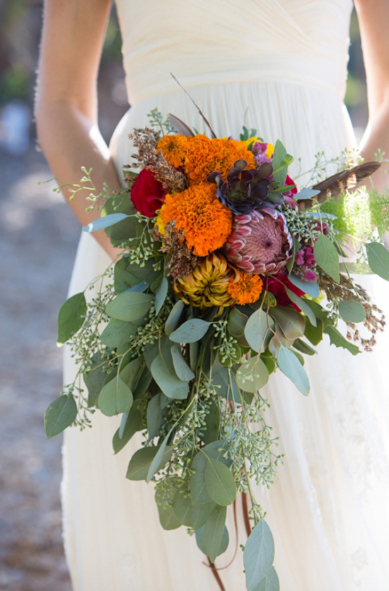 How gorgeous is this beautiful bouquet of bright colors? Loving the wild and organic look of the long greenery.