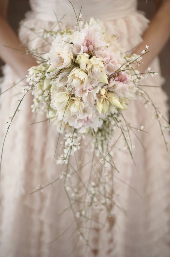 Starting this week off with this beautiful romantic bouquet. Subtle pale blush with long whimsical strands of Baby's Breath... a very pretty bouquet! Enjoy!