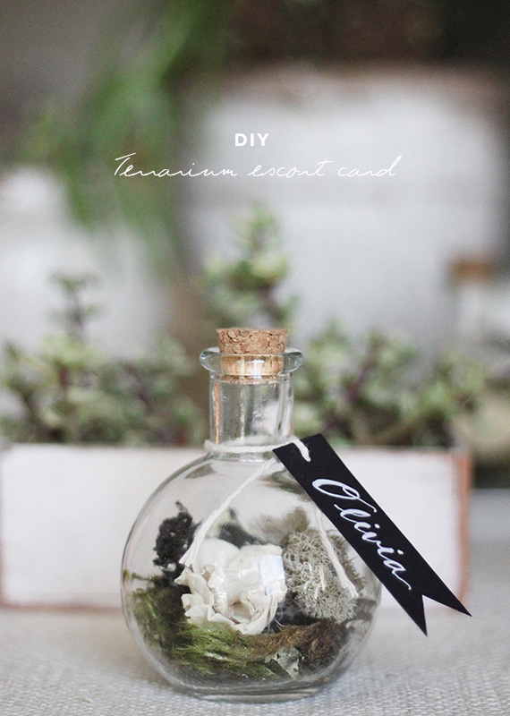 Loving everything about this diy terrarium escort card! From the dry mix of greens - to the hefty glass bottle - to the cute hand lettered tag... this is truly a beautiful diy project! Not only is it pretty, but it also acts as an escort card which then the guests can take home as favors!