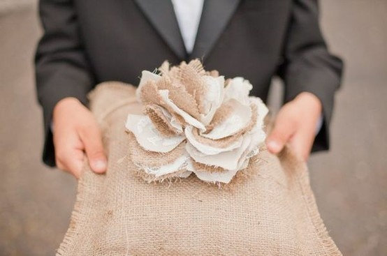 How cute is this ring bearer pillow? Handmade with love and topped off with a beautiful burlap flower, this pillow would look great at an outdoor rustic wedding!