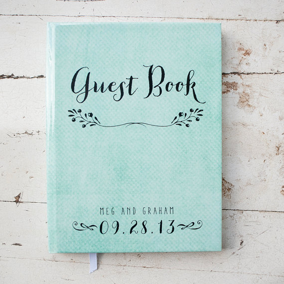 Our favorite this week is this pretty little thing. A handmade guestbook wrapped in what looks like teal watercolored print! The guestbook is a souvenir from your wedding that you'd want to keep - be sure to get one that you love!