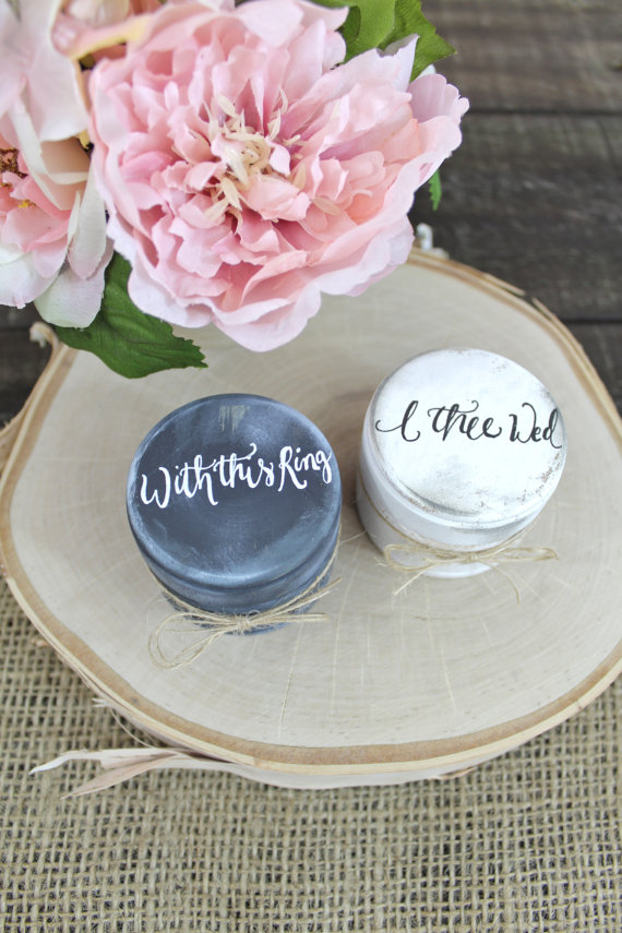 Oh, how pretty! Round cases with burlap pouches inside to hold the bride and groom's rings! Love the beautiful hand lettering.