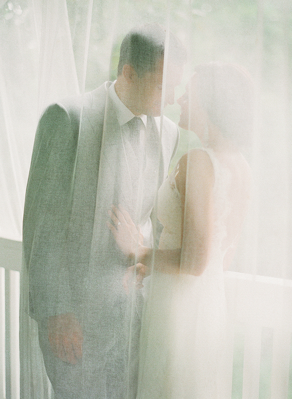 How romantic! Loving this romantic photo of the bride and groom sharing an intimate moment behind a sheer curtain! It's almost as if we got a sneak peek without them knowing - a must-have photo moment caught by the awesome Katie Stoops!