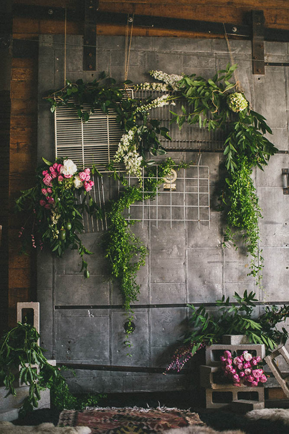 Inspiration Monday this week goes to this beautiful backdrop! Layers of industrial textures with bundles of greenery and flowers - romantic! This would be great for any outdoor industrial weddings!
