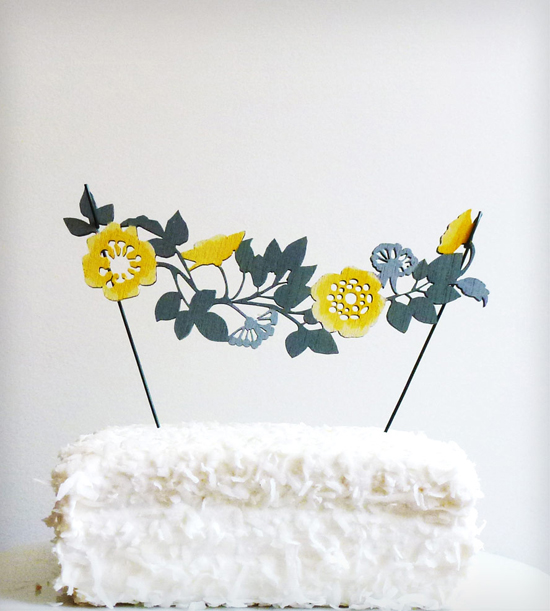 This beautiful wooden flower garland cake topper is our favorites of this week! Cut from plywood, it gives depth and texture to a cute illustrated flower garland to add a pretty wow factor to the top of any cake! Perfect for weddings, bridal showers, or any special event!