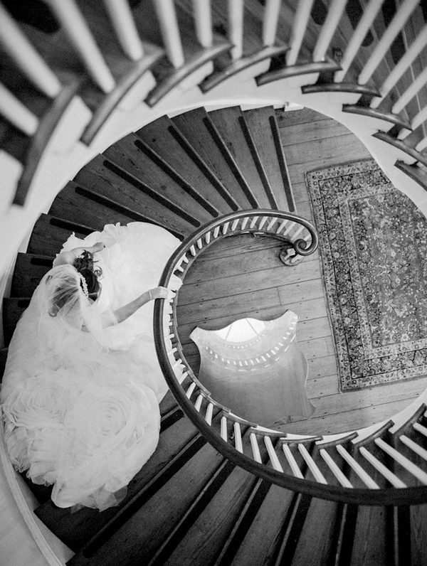 Definitely a must-have photo! How romantic is this shot of the bride descending the spiral staircase?