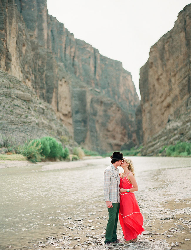 Oh, how romantic! Loving this beautiful engagement photo! A sweet kiss in the middle of the canyon - epic!