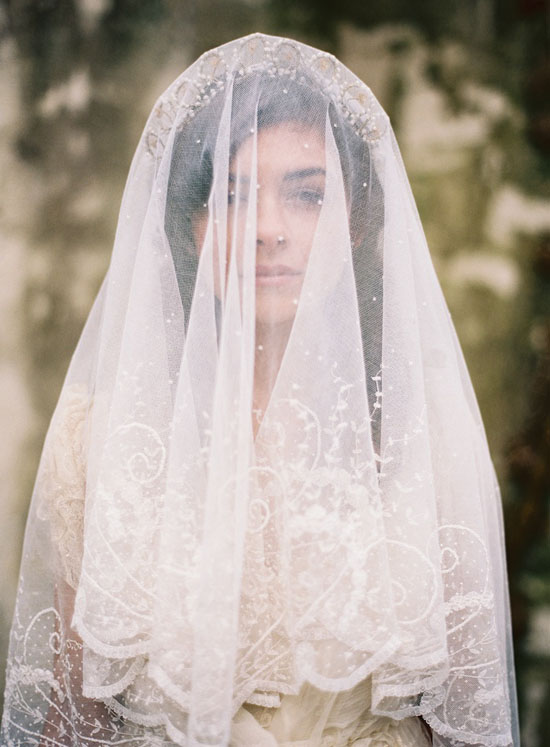 There's only one word to describe this image. Dreamy. What a breath taking photo... the vintage lace veil is just perfect! Take a look at the rest of the gorgeous wedding gallery here.