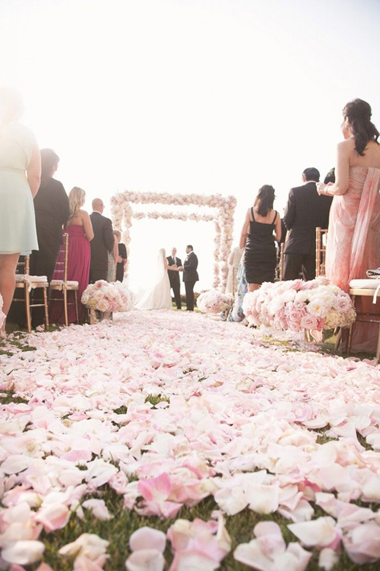 Oh, my goodness. How romantic! Imagine walking down an aisle covered with pretty little pink petals... it'd be a dream come true. A very, very, very happy dream!