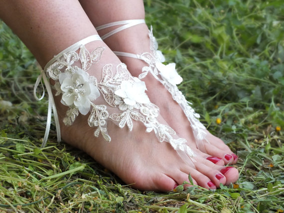 Favorites: Handmade Lace Bridal Beach Sandals // How pretty are these delicate lace wraps for your feet? These are perfect footwear for beach weddings or meadow/garden weddings ... fairy themed weddings! So many ways these handmade pretties can replace the typical heels - or wear them with your heels if you have a short wedding dress! Swoon.  Handmade Lace Bridal Beach Sandals by TheWorldofBrides