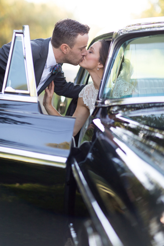 Must-Have Photo: Getaway Kiss // A romantic kiss between the bride and groom while getting in/out of your pretty getaway car? Definitely a must-have photo! Don't forget to let your photographer know if you have specific types of shots you'd like... like this one!