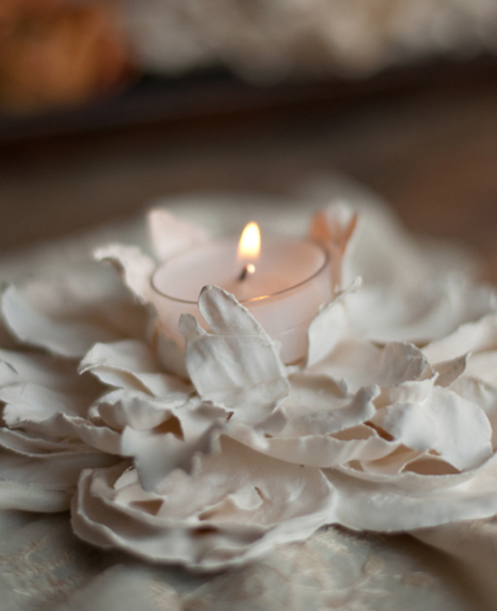DIY Plaster Dipped Flower Votives // I cannot use enough words to describe how much I love this tutorial! Plaster dipped flowers to use as candle votives - genius! Absolutely gorgeous! Definitely a keeper for any special events and, of course, your special day! Enjoy!