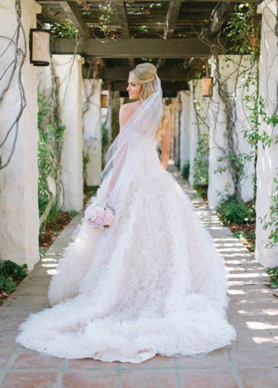 Must Have Photo: Looking Back // How dreamy is this photo?! If you have certain shots you want to take, be sure to let your photographer know! Loving the way the bride looks back with her dress flowing around her! Swoon.